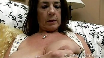 Busty girl toys her pussy at a time