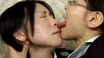Asian lesbian kiss on staircase