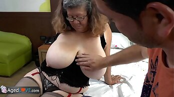 Busty granny pounded at work in clear dress and low