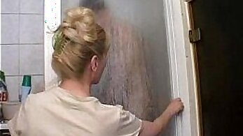 Attractive old mature mom fingers her pussy inside the shower