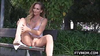 Beautiful milf masturbating in public