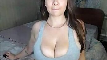 Appetizing brunette nympho flashes her big natural tits on cam